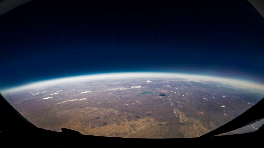 Thi layer of air over curve of earth
