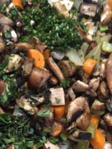 Mushrooms, onion, celery, carrots and fresh thyme and oregano