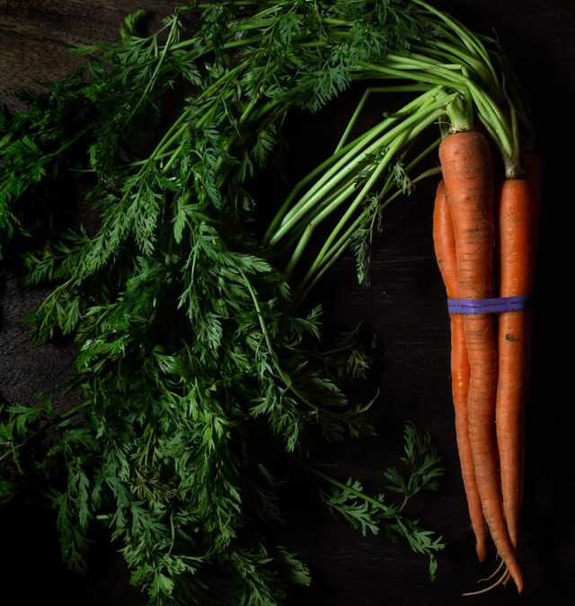 Carrots with stems and leaves